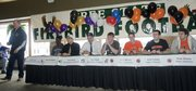 Free State football coach Bob Lisher introduces senior members of the team who signed to play football in college Thursday, at Alvamar Country Club, . From left are Khadre Lane, Butler County Community College; Reid Buckingham, Emporia State; Fred Wyatt, Northwestern; Joe Dineen, Kansas; and Lucas Werner, Keith Loneker and Blake Winslow, all with Baker University.