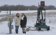 Neighbors Sara Yardley, left, and Amy Adamson live southeast of Baldwin City and are concerned abut the number of oil wells that are on their property and about the prospect of more being drilled too close to their homes.