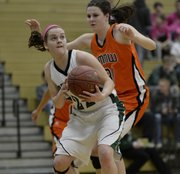 Free State senior Scout Wiebe looks for her shot against Shawnee Mission Northwest during their game, Friday, Feb. 7, 2014, at FSHS.