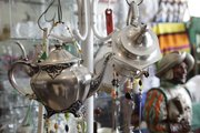 Mike Yoder/Journal-World Photo.URU Lawrence, 1113 Massachusetts St., features vintage pieces of home decor, furniture and jewelry that fill up the aisles and cases at the eclectic shop.