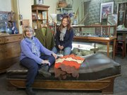 Mike Yoder/Journal-World Photo.Lois Mead, left and Eunha Chung, owner of URU Lawrence, 1113 Massachusetts St., value quality vintage pieces of home decor, furniture and jewelry that fill up the aisles and cases at the eclectic shop.