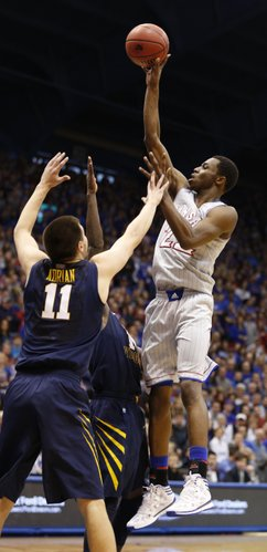 Kansas guard Andrew Wiggins puts up a shot against the West Virginia defense during the first half on Saturday, Feb. 8, 2014 at Allen Fieldhouse.
