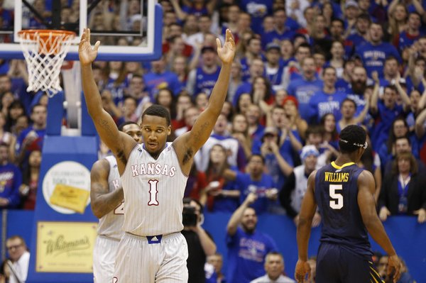 Kansas guard Wayne Selden raises up the fieldhouse during a timeout after hitting a three against West Virginia during the second half on Saturday, Feb. 8, 2014 at Allen Fieldhouse.