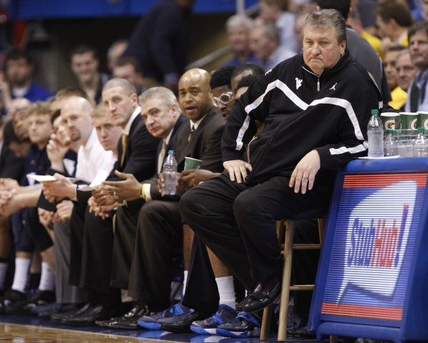 West Virginia head coach Bob Huggins stews on a stool during a stretch of bad play by the Mountaineers in the second half on Saturday, Feb. 8, 2014 at Allen Fieldhouse.