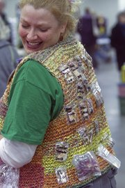 Susan Rader of Leavenworth sported a vest with seeds pinned to it for easy viewing as she attend the Fifth Annual Kaw Valley Seed Fair at the Douglas County Fairgrounds.