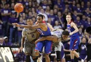 Kansas guard Andrew Wiggins tries to break through Kansas State players Marcus Foster, left, and Nino Williams for a loose ball during the first half on Monday, Feb. 10, 2014 at Bramlage Coliseum.