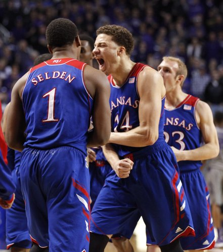 Kansas guard Brannen Greene (14) celebrates after the Jayhawks forced overtime against Kansas State at the end of the second half on Monday, Feb. 10, 2014 at Bramlage Coliseum.