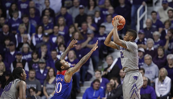 Kansas State guard Marcus Foster pulls up for a three before Kansas guard Naadir Tharpe during the second half on Monday, Feb. 10, 2014 at Bramlage Coliseum.