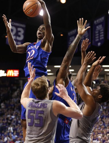 Kansas guard Andrew Wiggins grabs an offensive rebound over the Kansas State defense during the second half on Monday, Feb. 10, 2014 at Bramlage Coliseum.