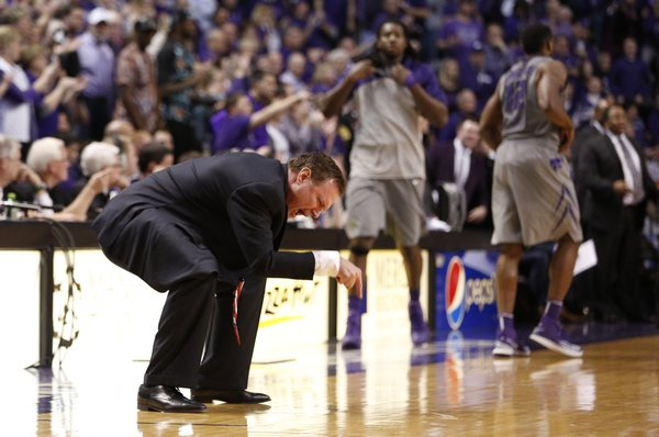 Kansas head coach Bill Self points to the floor while disputing a traveling call against forward Perry Ellis during the second half on Monday, Feb. 10, 2014 at Bramlage Coliseum.