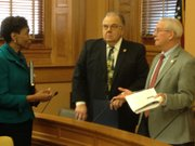 Kansas University Chancellor Bernadette Gray-Little speaks with state Sen. Tom Arpke, R-Salina in February. In the center is state Sen. Steve Abrams, R-Arkansas City.