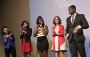 Mike Yoder/Journal-World Photo.From left Precious Jacob, Marcya' Floyd, Jazmen Fowler and Hannah Moyer applaud as their fellow Boys and Girls Club Youth of the Year candidate Innocent Anavberokhai, was named as winning the award Wednesday night in a ceremony at the Lawrence Arts Center.