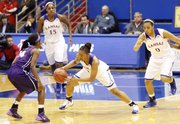 Kansas guard Cece Harper, (24) center, comes up with steal during the Jayhawks' victory against TCU, Wednesday, Feb. 12, 2014, at Allen Fieldhouse.