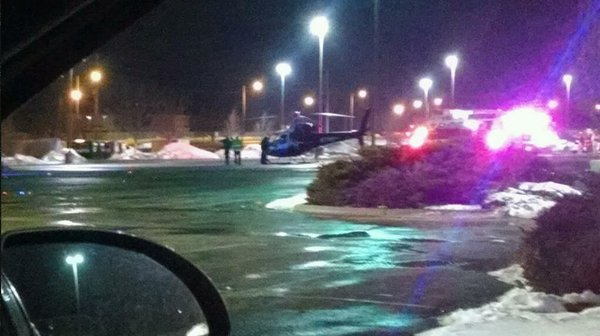 A Life Star air ambulance standing by in the 6th Street Hy-Vee parking lot to transport the shooting victim.