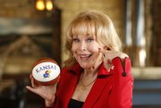 "Actress Barbara Eden, who played Jeannie on the 1960s television series ""I Dream of Jeannie,"" can't deny her love for Kansas basketball. Eden will be in attendance at Allen Fieldhouse for Saturday's game between the Jayhawks and the Horned Frogs of TCU with her husband, Jon Eicholtz, who is a Kansas University graduate."