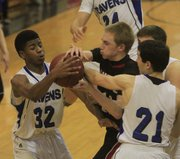 Lawrence senior Connor Henrichs (10) fights for a possession on Friday, Feb. 14, 2014, in Olathe.