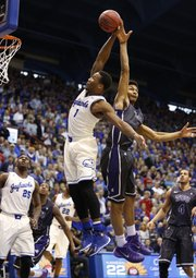 Kansas guard Wayne Selden is fouled by TCU center Karviar Shepherd as he pulls back for a dunk during the first half on Saturday, Feb. 15, 2014 at Allen Fieldhouse.