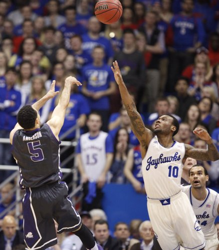 Kansas guard Naadir Tharpe defends as TCU guard Kyan Anderson pulls back for a shot during the first half on Saturday, Feb. 15, 2014 at Allen Fieldhouse.