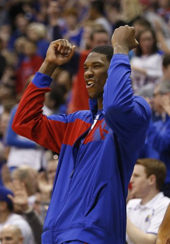 Injured Kansas center Joel Embiid celebrates a dunk by forward Tarik Black during the second half on Saturday, Feb. 15, 2014 at Allen Fieldhouse.
