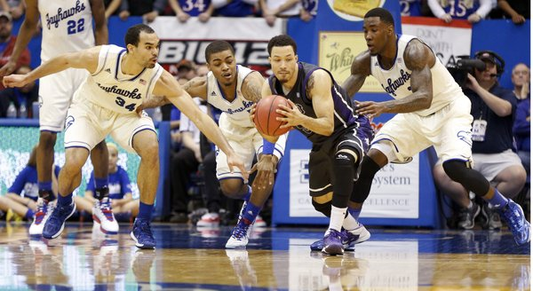 Kansas defenders Perry Ellis, left, Frank Mason and Jamari Traylor get after TCU guard Kyan Anderson during the second half on Saturday, Feb. 15, 2014 at Allen Fieldhouse.