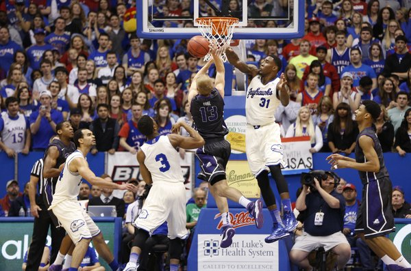 Kansas forward Jamari Traylor rejects a shot from TCU guard Christian Gore during the second half on Saturday, Feb. 15, 2014 at Allen Fieldhouse.