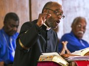 The Rev. Verdell Taylor Jr. delivers a sermon during a worship service at St. Luke AME church, 900 New York St., on Sunday, Feb. 16, 2014.