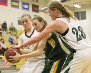Free State's Madison Piper (23) and Hannah Shoemaker, left, double team Shawnee Mission South's Sam Kilzer, center, as they apply full-court pressure during their game, Tuesday at FSHS.