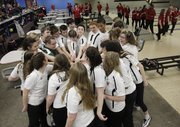 Members of the Free State bowling teams gather for a pep talk before a bowling competition Tuesday against Lawrence High at Royal Crest Lanes.