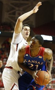 Kansas center Joel Embiid ducks under Texas Tech forward Dejan Kravic during the first half on Tuesday, Feb. 18, 2014 at United Spirit Arena in Lubbock, Texas.