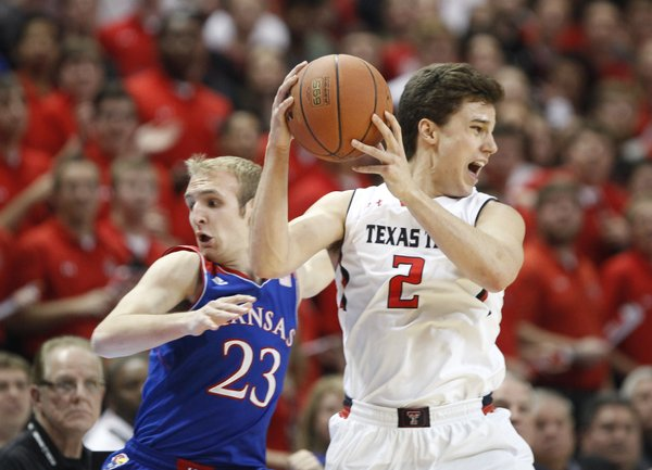 Kansas guard Conner Frankamp heads out of bounds as Texas Tech guard Dusty Hannahs tries to save the ball during the first half on Tuesday, Feb. 18, 2014 at United Spirit Arena in Lubbock, Texas.