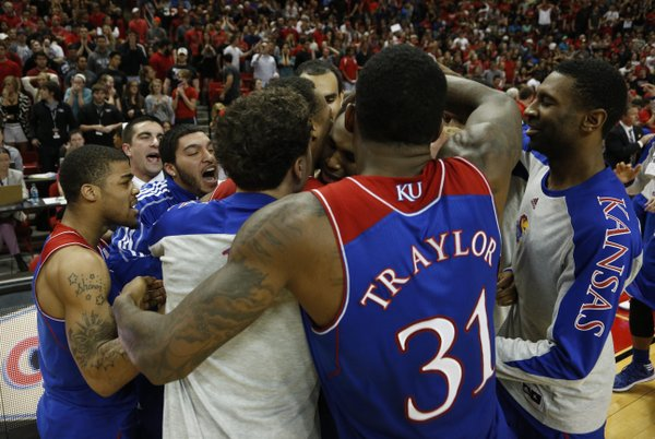 Kansas players mob Andrew Wiggins after Wiggins' last-second bucket lifted the Jayhawks over Texas Tech, 64-63 on Tuesday, Feb. 18, 2014 at United Spirit Arena in Lubbock, Texas.