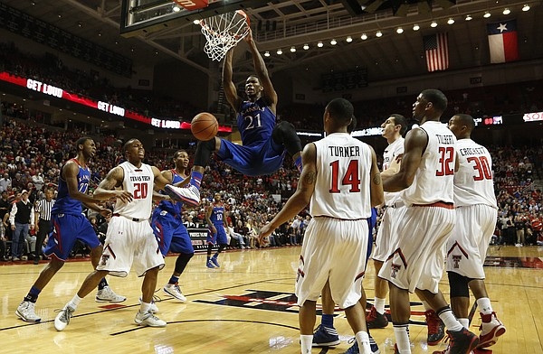 Kansas center Joel Embiid delivers a dunk against Texas Tech to give the Jayhawks the lead with less than 30 seconds on Tuesday, Feb. 18, 2014 at United Spirit Arena in Lubbock, Texas.