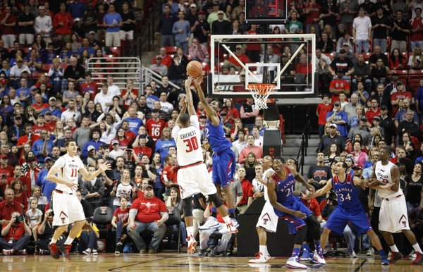Kansas guard Andrew Wiggins blocks a shot from Texas Tech forward Jaye Crockett late in the game on Tuesday, Feb. 18, 2014 at United Spirit Arena in Lubbock, Texas.