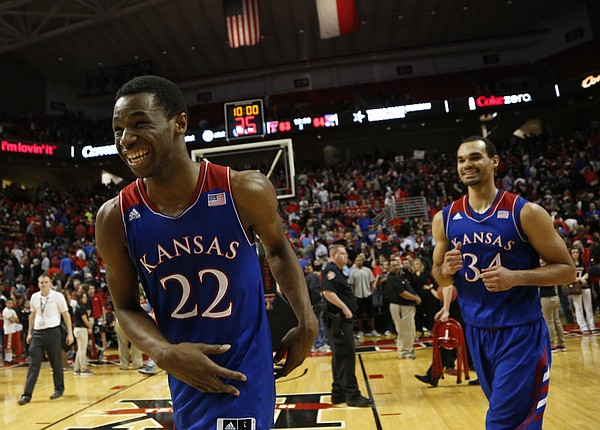 Kansas guard Andrew Wiggins flashes a wide smile after getting a bucket with seconds left to life the Jayhawks over Texas Tech 64-63 on Tuesday, Feb. 18, 2014 at United Spirit Arena in Lubbock, Texas. At right is Kansas forward Perry Ellis.
