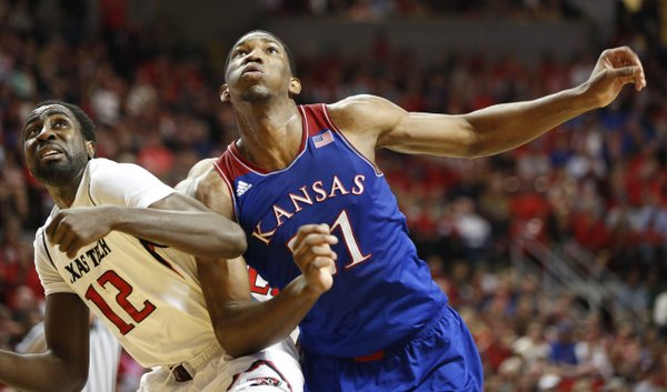 Kansas center Joel Embiid battles for position against Texas Tech forward Kader Tapsoba during the second half on Tuesday, Feb. 18, 2014 at United Spirit Arena in Lubbock, Texas.