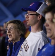 Rosalie Gerstner and her grandson Brian Gerstner sing the Alma Mater prior to the Jayhawks' tipoff against TCU on Saturday, Feb. 15, 2014, at Allen Fieldhouse.