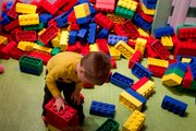 The Kid plays with some super-sized Duplo Legos at Legoland Discovery Center at Crown Center in Kansas City. Mo.