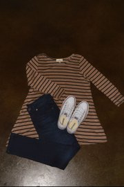 An outfit featuring a striped shirt from Anthropologie, jeans from Gap, and Converse shoes from Urban Outfitters