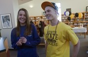 Free State's Bailey Sullivan, left, and Stan Skwarlo signed track letters of intent, Sullivan with TCU and Skwarlo with Wichita State, during a ceremony Friday at FSHS.