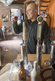 Lawrence homebrewer Angelo Ruiz tastes some beer he made at his home. Ruiz is the president of the Lawrence Brewers Guild. He and other local homebrewers are hoping a bill will succeed in the Kansas Senate that would ease restrictions on how homebrewers can share their product.
