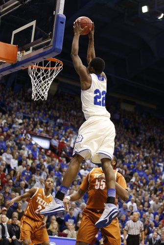 Kansas guard Andrew Wiggins catches a pass well above the rim for a dunk against Texas during the first half on Saturday, Feb. 22, 2014 at Allen Fieldhouse.
