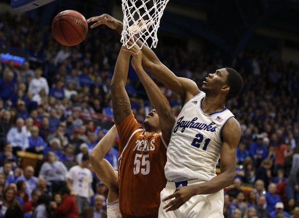 Kansas center Joel Embiid rejects a shot by Texas center Cameron Ridley during the second half on Saturday, Feb. 22, 2014 at Allen Fieldhouse.