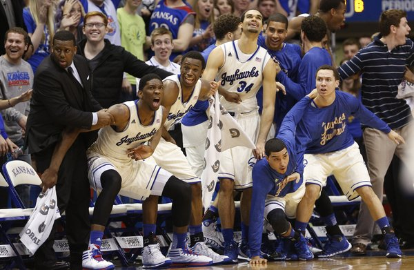The Kansas bench reacts with disbelief after a dunk by forward Tarik Black sent the fieldhouse into a frenzy during the second half on Saturday, Feb. 22, 2014 at Allen Fieldhouse.
