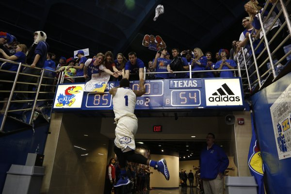 Kansas guard Wayne Selden jumps to slap hands with a row of Jayhawk fans after defeating Texas 85-54 on Saturday, Feb. 22, 2014 at Allen Fieldhouse.