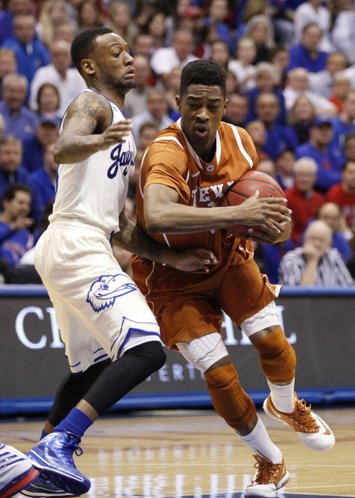 Kansas guard Naadir Tharpe defends against a drive by Texas guard Isaiah Taylor during the second half on Saturday, Feb. 22, 2014 at Allen Fieldhouse.
