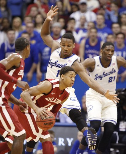 Kansas guard Wayne Selden defends a drive by Oklahoma guard Isaiah Cousins during the first half on Monday, Feb. 24, 2014 at Allen Fieldhouse.