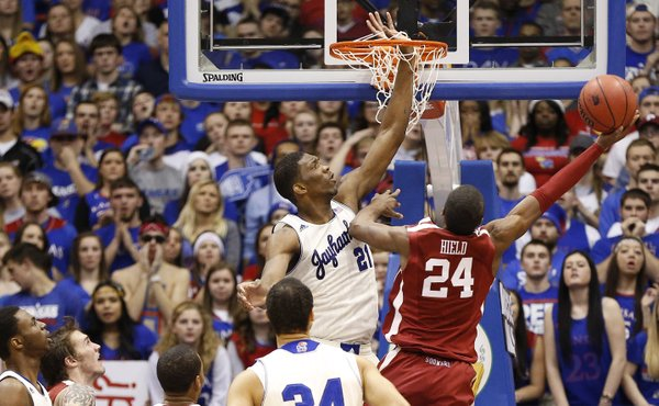 Kansas center Joel Embiid gets his hand caught in the net as he tries to block a shot by Oklahoma guard Buddy Hield during the second half on Monday, Feb. 24, 2014 at Allen Fieldhouse.