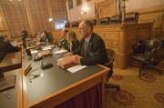 Rep. Tom Sloan listens to testimony during a hearing on commercial driver's license testing.