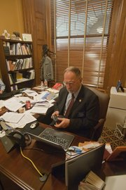 Rep. Tom Sloan spends a lot of his down time in Topeka answering constituent emails.