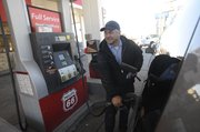 """Richard Haig owns Westside 66 at 2815 W. Sixth, the last full-service gas station in Lawrence. """"We have people who think they're pulling up to a self-service pump,"""" says Haig, who has owned the station since 1985. """"When we come out to start pumping their gas, we get some blank stares."""""""